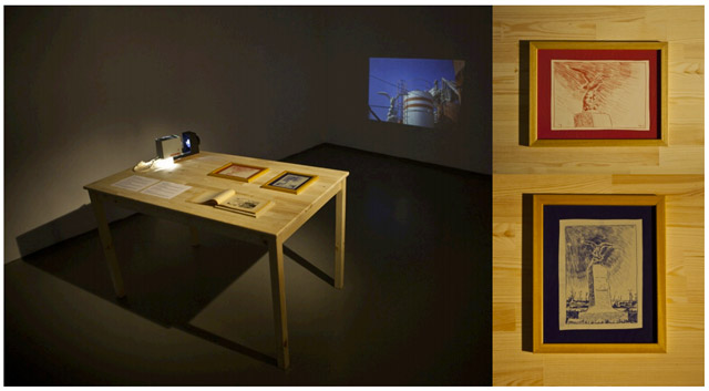 "Borga Kantürk, ""Seagull with Glasses"", 2011. Installation with slide projector, projected photograph, two framed drawings (20 x 25 cm), 2 texts (on A4-sized paper), found caricature album, wood table."