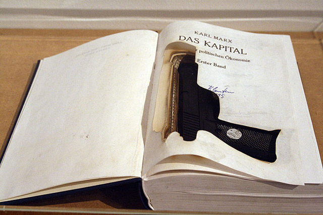 Halil Altındere, Das Kapital. 2009. Laser cut book, gun, 21,5 x 15 x 4,3 cm, 3 C-Prints, mounted on Alu-Dibond,each 50 x 35 cm (Detail).