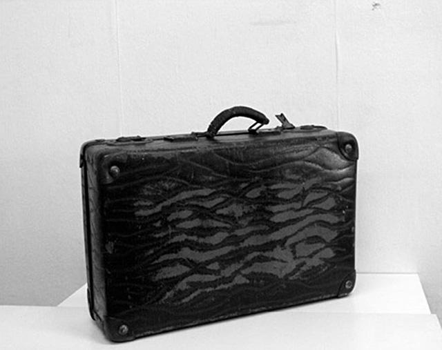 Nancy Atakan, Lost Suitcase, 3:36 digital video, original 2009 / revised 2011.