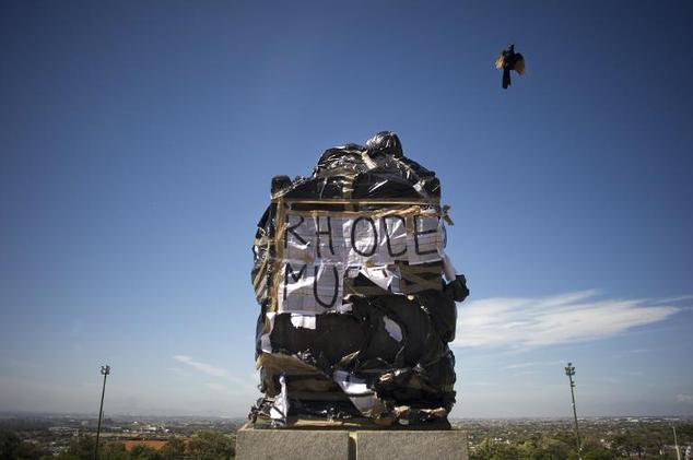 Cecil Rhodes' statue, covered up by students of Cape Town University (2015).